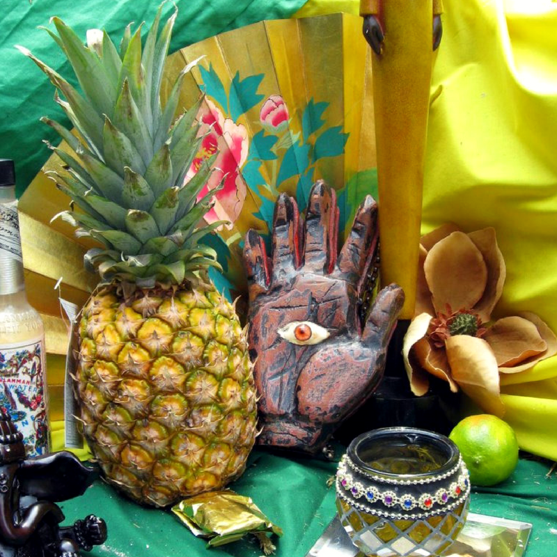 Creating cordials - preserving memories as well as the harvest - image from a drum altar on pixiespocket.com