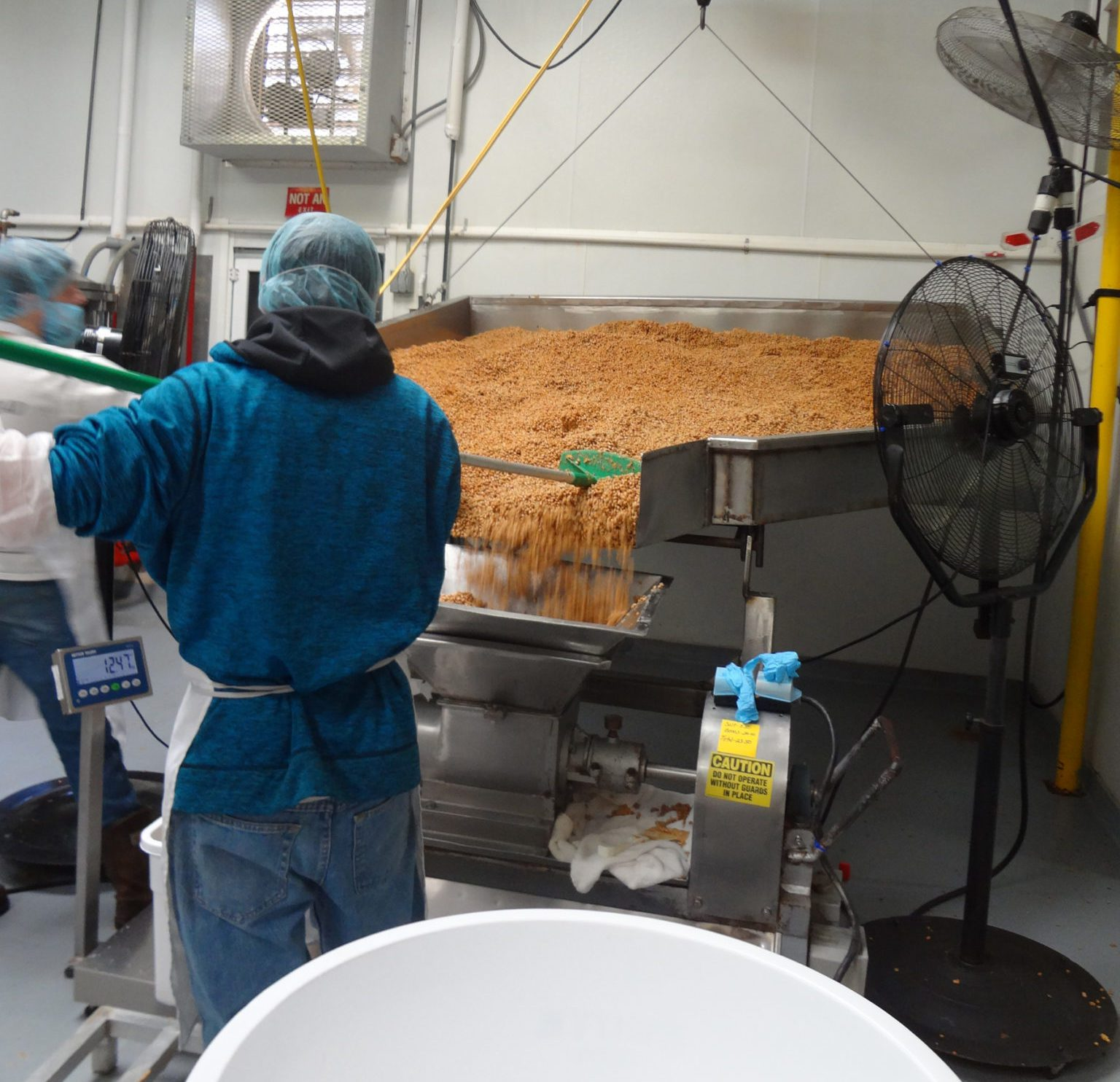 Miso Master Tour as seen on pixiespocket.com - An employee moves the soybeans used to create the miso paste.